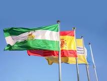 安大路西亚、西班牙、伊斯拉克里斯蒂纳和蓝旗信号振翼的旗子  库存照片