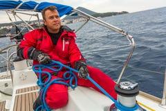 安德罗斯,希腊-水手参加航行赛船会 库存照片
