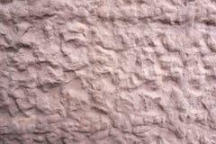 安心墙壁的纹理在桃红色颜色的 库存图片