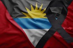 安提瓜和巴布达旗子有黑哀悼的丝带的 免版税库存照片