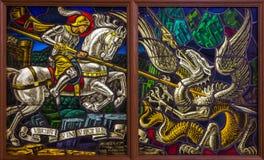 安特卫普-圣Georeg决斗窗玻璃有恶魔的在Joriskerk或圣乔治教会里 库存图片