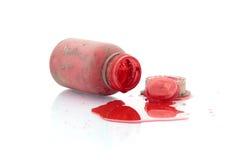 安置瓶红色在白色背景 免版税库存照片