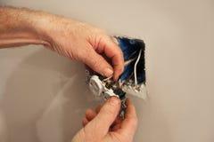 安装新的电子插口 库存照片