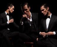 安装的商人3个姿势在看的黑色的  免版税图库摄影