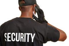 治安警卫从后面 库存照片