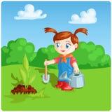 完成庭院工作的女孩 免版税库存照片