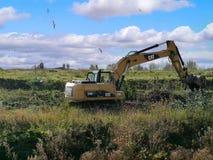 完成开垦工作的挖掘者 库存照片