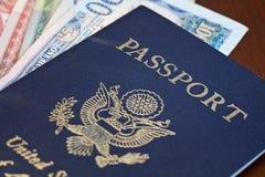宏指令被射击在外币的护照 免版税库存照片
