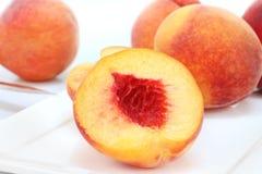 宏观桃子牌照白色 免版税库存照片
