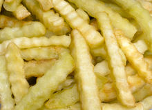 宏观皱纹的炸薯条 免版税库存照片