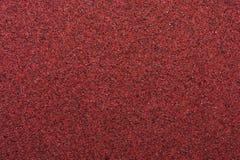 宏观红色沙纸 免版税图库摄影