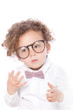 宏观逗人喜爱的卷曲孩子佩带的眼睛玻璃 免版税库存照片