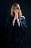 宗教祈祷的妇女 免版税库存照片