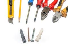 定缝销钉和螺丝,螺丝刀,钳子,铅笔 免版税库存图片
