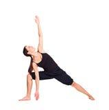 实践的俏丽的女子瑜伽 免版税库存图片