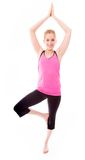 实践的女子瑜伽年轻人 免版税库存图片