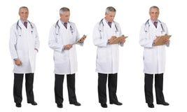 实验室外套全长四个不同姿势的医生 免版税库存照片