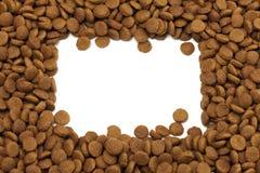 宠物(狗或猫)食物方形的框架为ackground使用 库存图片