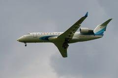 客机在一个多云天空特写镜头的投炸弹者CRJ-200ER VQ-BSB Yamal航空公司 免版税库存图片