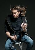 宣扬演奏摇滚明星的吉他 库存照片