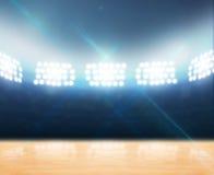 室内探照灯照明的健身房 免版税库存图片