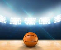 室内探照灯照明的篮球场 免版税库存图片