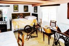 室在农舍19世纪 手纺车 免版税库存照片