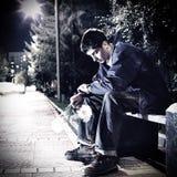 室外哀伤的年轻的人 库存照片
