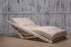 室外家具是一个舒适的折叠的沙发 库存图片