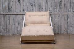 室外家具是一个舒适的折叠的沙发 库存照片