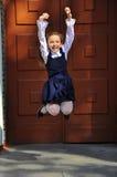室外愉快和美丽的学校的女孩 图库摄影