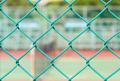 室外被弄脏的网球笼子  免版税库存图片