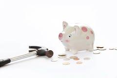 害怕存钱罐是对捣毁在白色背景 免版税库存照片