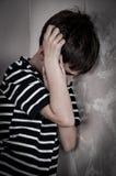 害怕的和被虐待的年轻男孩 图库摄影