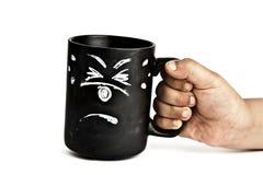 害怕的杯子手持式 免版税库存图片