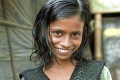 害羞的微笑的女孩画象有穿甲的 图库摄影