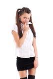 害臊纵向女小学生 免版税库存图片