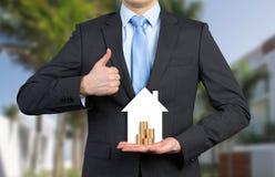 家和硬币 免版税图库摄影
