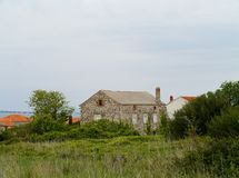 家在海岛的奥利布岛村庄 免版税库存图片