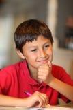 家庭作业的年轻男孩图画 免版税库存图片