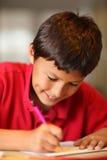 家庭作业的年轻男孩图画 免版税库存照片