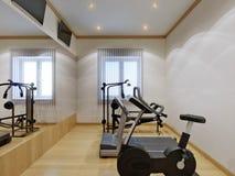 家庭健身房内部用健身设备 免版税库存图片