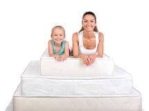 家庭和许多床垫 免版税图库摄影