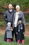 家庭在冬天 库存照片