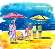 家庭在度假由海的 免版税库存照片