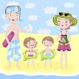 家庭在度假由海的 库存图片