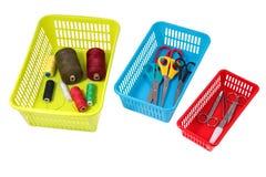 家庭存贮系统,有房子的色的塑料穿孔的箱子 免版税库存图片