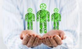 家庭成员的绿色标志作为一个机制的在人棕榈提出了 库存照片