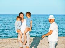 家庭海假期世代 库存照片