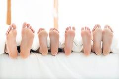 家庭的脚 免版税库存照片